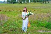 Beautiful woman wiyh bunch of flowers — Stock Photo