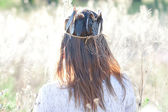 Young woman in the crown with feathers — Stock Photo