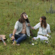 Stock Photo: Hippie couple smell fragrance of flowers
