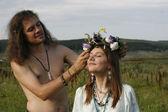 Hippie put on wreath of flowers — Stock Photo