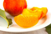 Pieces sweet rich bright peach — Stock Photo