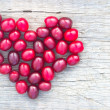 Heart with cornelian cherry — Stock Photo