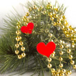 Pine branche adorned beads and hearts — Stock Photo