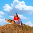Stock Photo: Young hippie siting on hillock