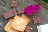 Flowers, milk chocolate and pastry — Stock Photo