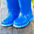 Blue child's wellington boots — Stock Photo