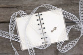 Romantic notebook and white lace — Stock Photo