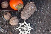 Ebony, walnut, fir cone and New Year's wood star — Stock Photo