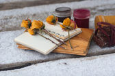 Notebook, dry rose, paint and chocolate — Stock Photo