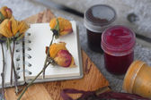 Notebook, dry rose, paint — Стоковое фото