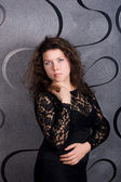 Woman in a strict black lace dress — ストック写真