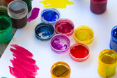 Open jars with gouache different colors — Stock Photo