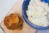 cottage in blue plate and cheese fritters — Stock Photo