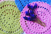 Blue spring flowers on a crochet napkins — Stock Photo