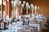 Decorated tables with candelabra at wedding reception, selective — Stock Photo