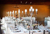 Wedding reception hall with decorated tables — Stock Photo