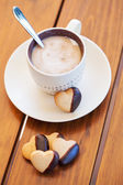 Cup of coffee and heart shaped biscuits — Stock Photo