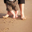 Mother and baby walking on beach — Stock Photo