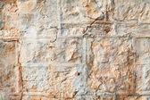 Un muro de piedra arenisca natural degradado — Foto de Stock