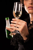 Woman poured a glass of sparkling wine — Stock Photo