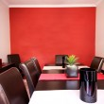 Постер, плакат: Dining room interior with red wall