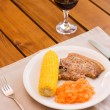 Light lunch served with red wine — Stock Photo