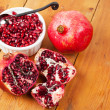 Stock Photo: Pomegranate fruit and pips in white bowl