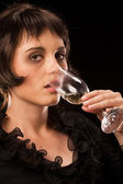 Attractive young woman drinking champagne — Stock Photo