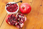 Pomegranate fruit and pips in a white bowl — Stock Photo