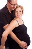 Man holding his pregnant wife's belly — Foto de Stock