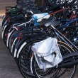 Bicycles parked in a row next to the road — Stock Photo