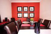 Dining room interior with red wall — Stock Photo
