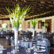 Wedding reception venue with decorated tables and fairy lights — Stock Photo #39353521