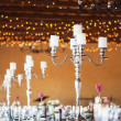 Candelabrwith candles on decorated wedding reception tables — Stock Photo #39353829