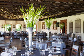 Wedding reception venue with decorated tables and fairy lights — Stock Photo