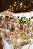 Wedding reception hall with laid tables — Stock Photo