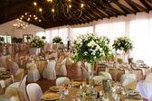 Indoors wedding reception venue with decor — Stock Photo