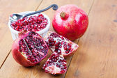 Pomegranate fruit and pips in bowl — Stock Photo