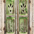 Stock Photo: A Grungy old green wooden window