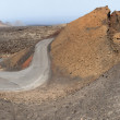 Timanfaya National Park, Road in volcanic stone desert on Lanzarote, Canary islands, Spain — Stock Photo #22477169