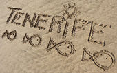 Tenerife, sand writing on the beach of El Papagayo — Stock Photo