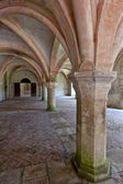 Old colonnaded interior shot in the Abbaye de Fontenay in Burgundy, France — Stock Photo