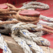 Bitt rope on a bollard of berth - Stock Photo