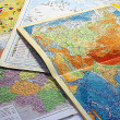 Geographical maps. The student's life. — Stock Photo