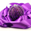 Purple ribbon and ball — Stock Photo