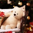 Stock Photo: Festive soft bruin with gifts under New-year tree