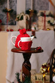 A cup and tea-pot is in New-year scenery — Stock Photo