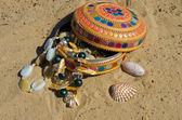 Casket with a beads on the sandy shore — Stock Photo