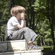 Pensive boy on threshold — Stock Photo #27198197