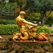 Fountain with a statue of Triton — Stock Photo